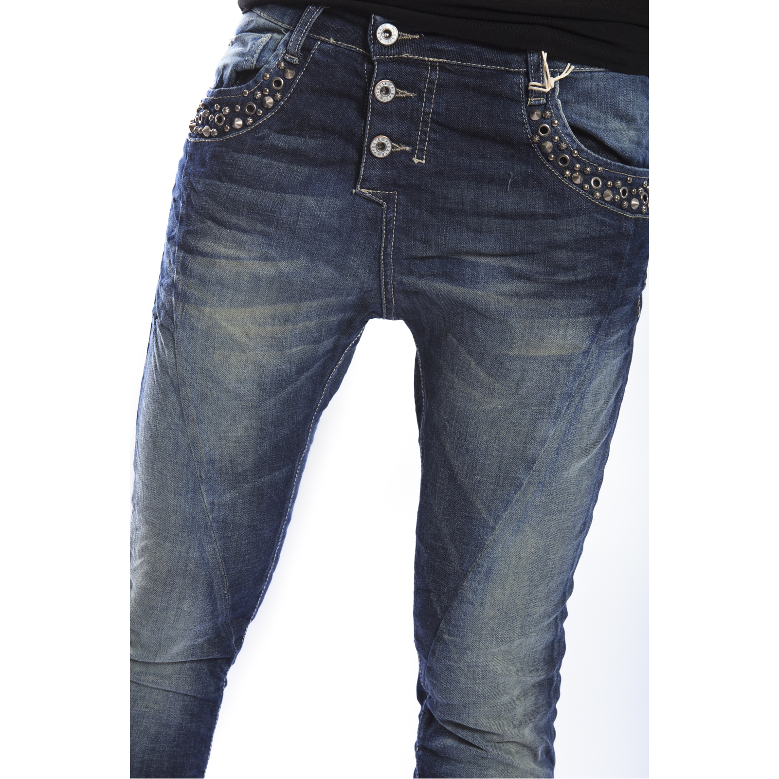 Studded jeans go wonderfully well with leather, so try black or brown boots, too. There are many styles of women's jeans with gorgeous studded patterns. Capris with studs and designs on the pockets are fun, especially during a night of excitement and adventure.